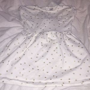 White colored Carters dress. With some gold dots